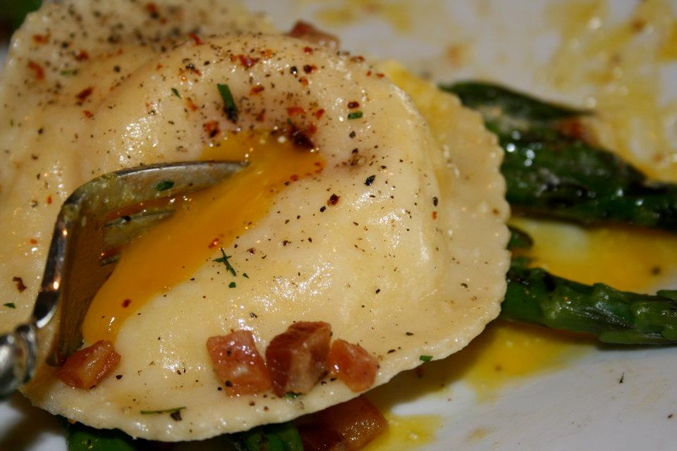 ravioli UOVO egg yolk & ricotta filled over grilled asparagus